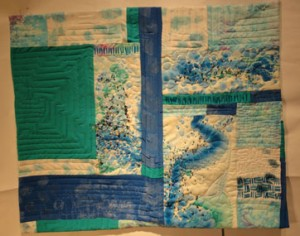 Full shot of the quilt showing the fianl layout with the beadwork and the final quilting