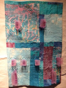 turquoise and pink quitl with 3-d parts on top