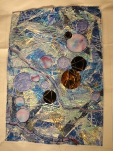 blue and purple paper quilt with gold cirles and openings