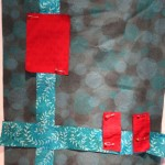 blue green backgrouns with turqupise strips and crimson blocks on top