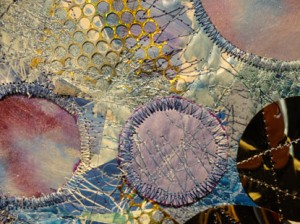 close up showing details of  gold sequin waste two partial openings and one added circle