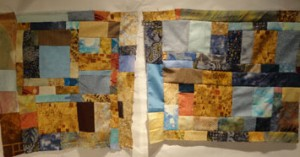 Brown, blue and aqua blocks arranged in a random fashion for two pillows.