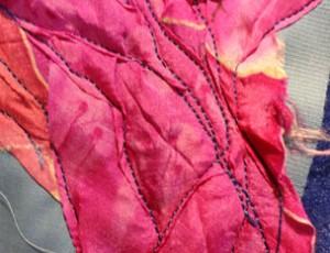 wrinkled fusha silk sewn down with blue thread